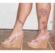 Long Chained Floral Design Tattooed Across Leg Ankle And Foot