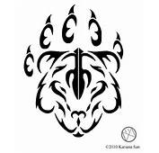 Tribal Bear Paw And Face Tattoo