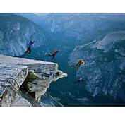 Photo A Group Of Climbers Jump From Half Dome