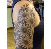 Wonderful Daisy Tattoo On Back