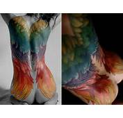 Sexy Full Back Tattoo On A Woman That Shows Angel Wings In Rainbow