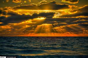 ... over-atlantic-ocean-with-sun-rays-going-trhough-clouds.jpg (1200×799